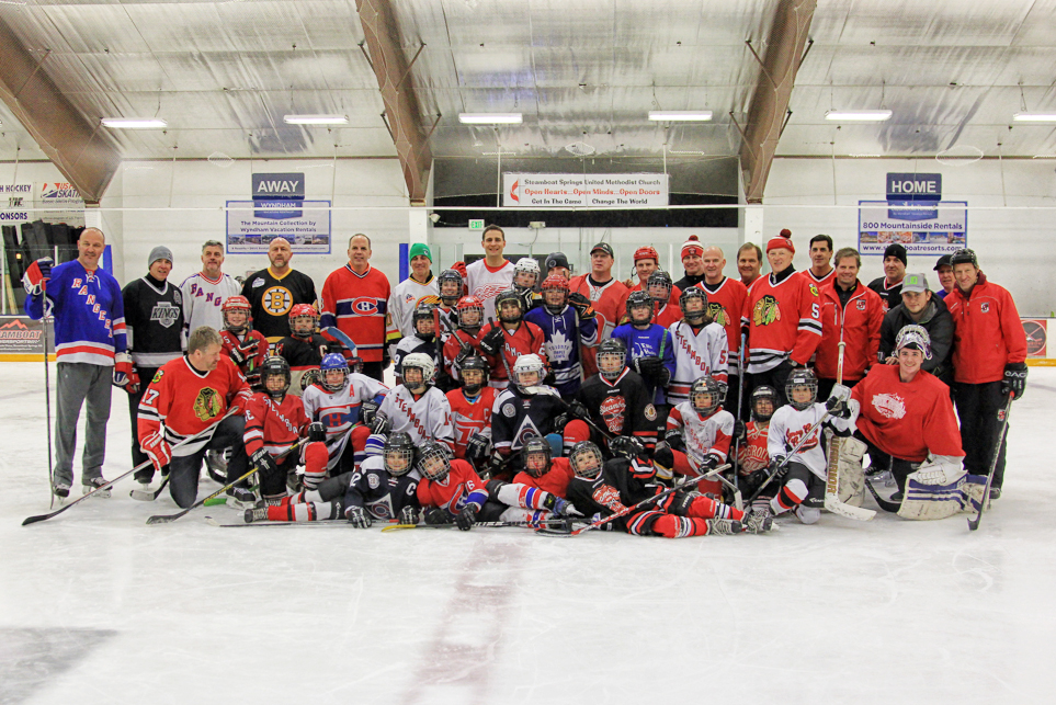Steamboat Springs youth hockey players pose for a picture alongside more than a dozen NHL alumni during last week's Steamboat Hockey Classic at Howelsen Ice Arena.