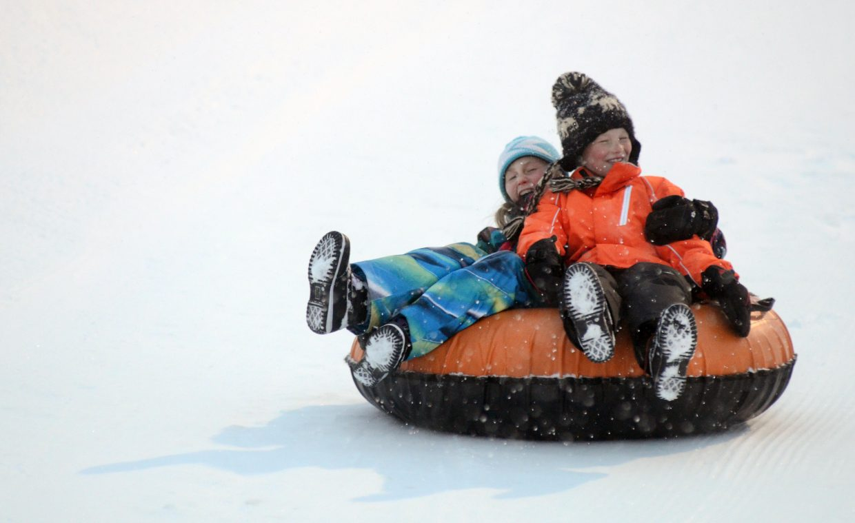Paris McMahon and her cousin Kai Hush got in a dual snow tubing ride at Howelsen Hill during the Community Holiday Party. The Rotary Club of Steamboat Springs hosts the event that will take place on Sunday from 4 to 7 p.m. with tubing, caroling, Santa's workshop, refreshments and more.