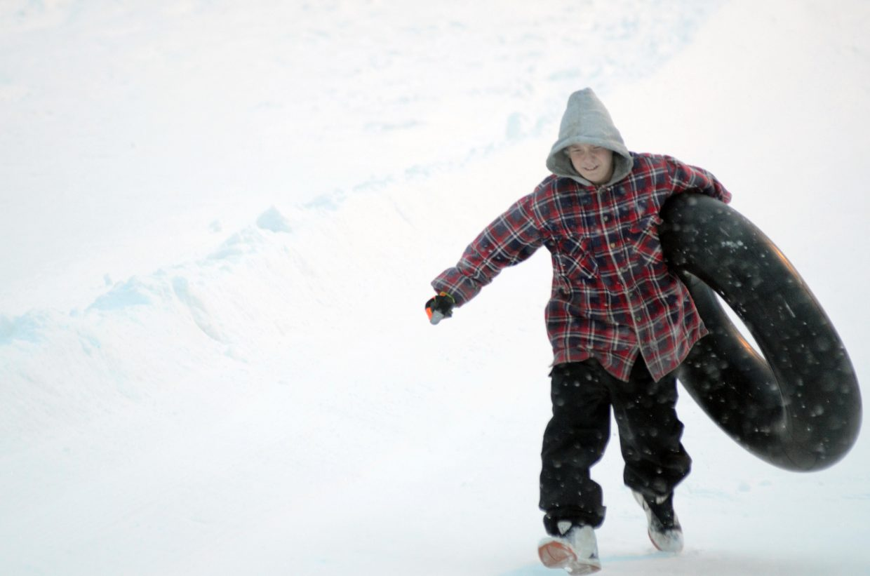 Louden Kirby, 12, didn't quite make it down the hill on his tube Sunday during the Community Holiday Party at Howelsen Hill.