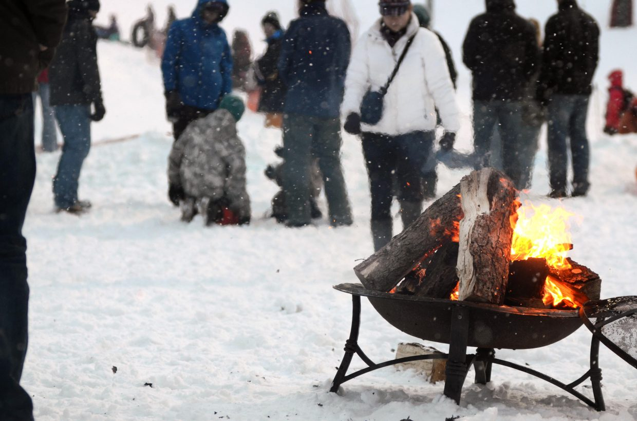 A pair of fires blazed away at the base of Howelsen Hill, keeping visitors warm on a snowy evening at the Community Holiday Party.
