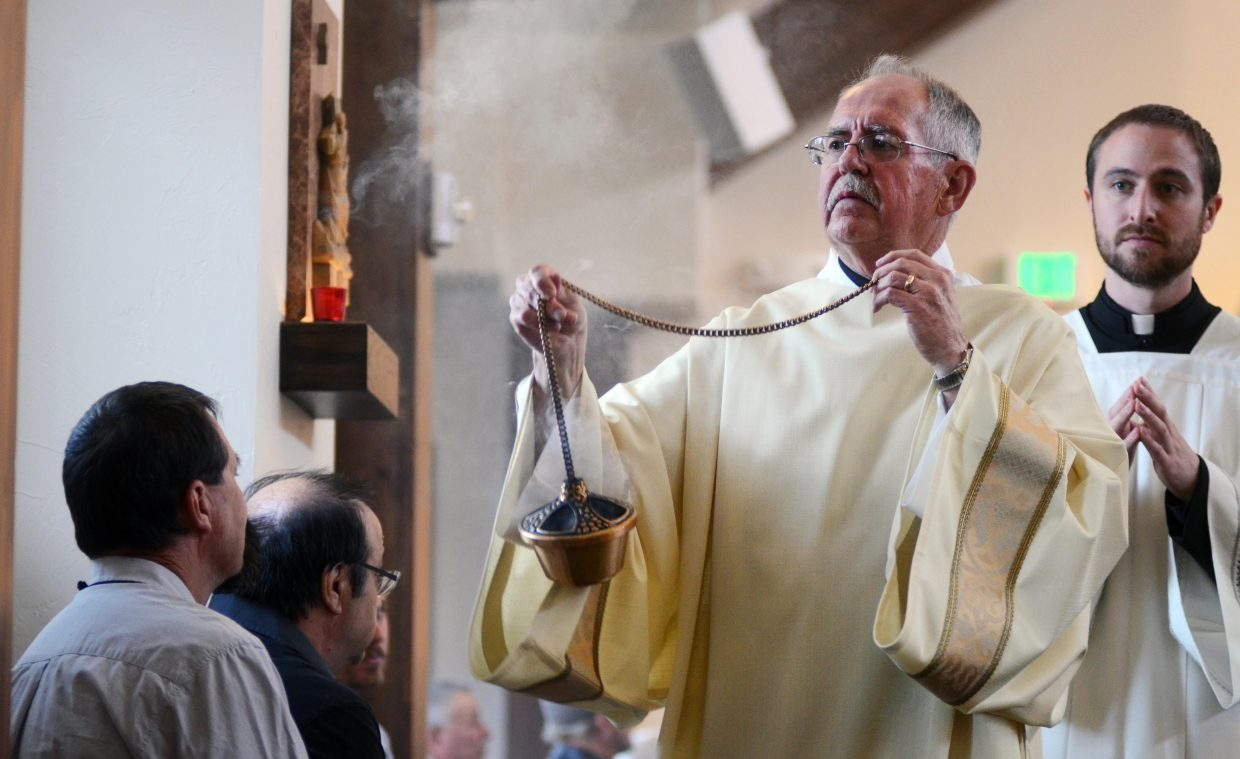 Deacon Bill Ertmer blesses the new Holy Name Catholic Church on Sunday in downtown Steamboat.