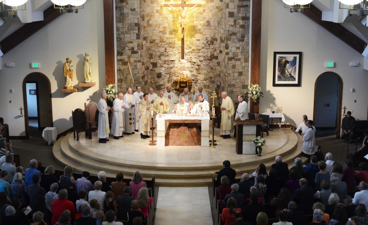 The dedication of the new Holy Name Catholic Church drew an enormous crowd Sunday. The Rev. Samuel J. Aquila, archbishop of Denver, led the afternoon Mass.