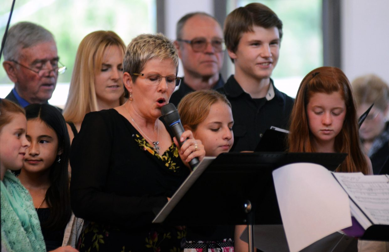 """The youth choir performed """"Lord I Lift Your Name on High"""" during the prelude music for the dedication of the new Holy Name Catholic Church."""