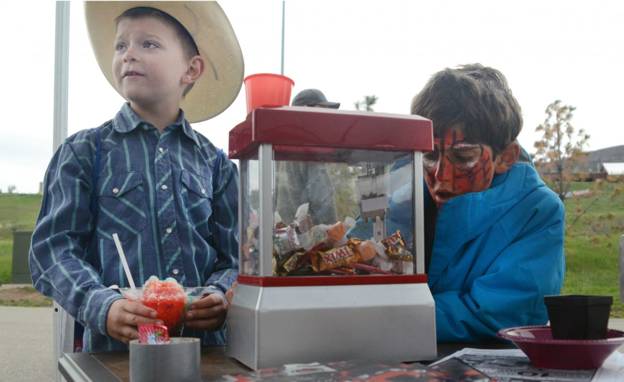 North Routt Community Charter School student Jason Heid, left, and Strawberry Park Elementary School student Colton Casavecchia play with a candy dispenser at the Sears booth at the Home and Garden Expo on Saturday morning.