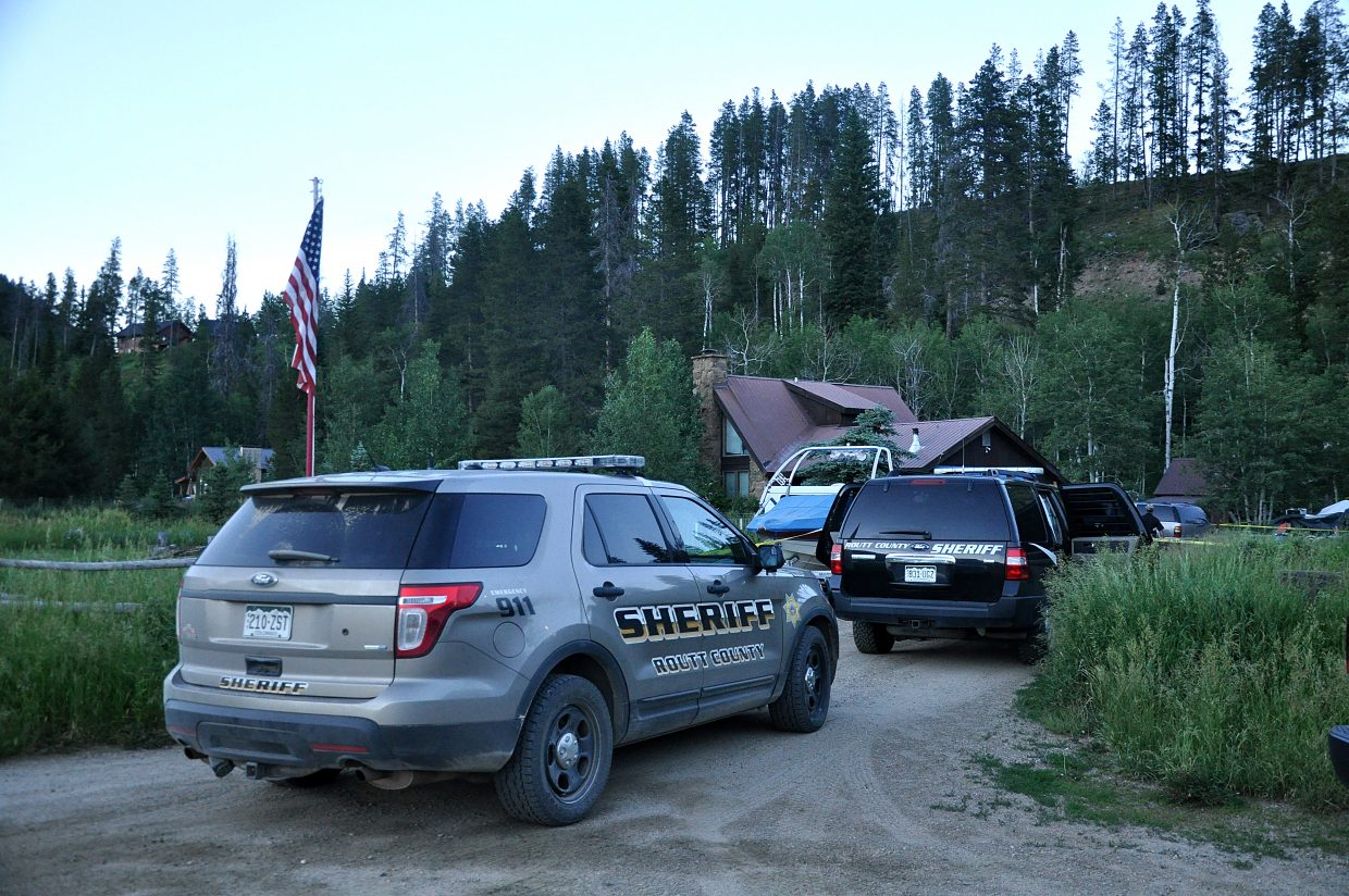 Investigators with the Routt County Sheriff's Office work at the scene of a suspected homicide in North Routt County on Monday night.
