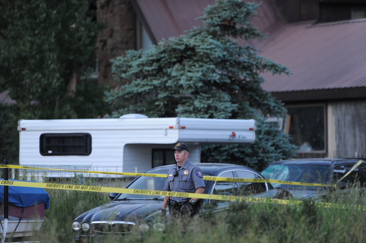 Routt County Sheriff's Office deputy JD Paul works at the scene of a suspected homicide in North Routt County on Monday night.