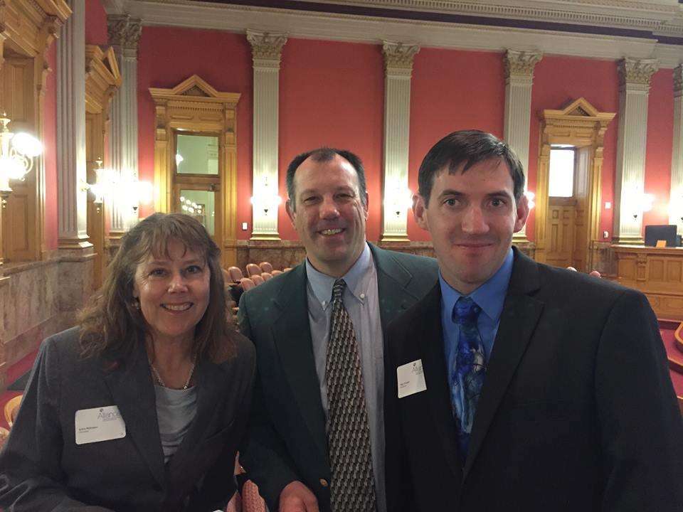 Moffat County Horizons team coordinator Sylvia McFeaters, left, Routt County Horizons counselor and volunteer coordinator Tommy Larson, center, and Matt Troeger pose at the Colorado capital last week. McFeaters and Larson were finalists for Alliance Colorado's Direct Support Professional of the year award.
