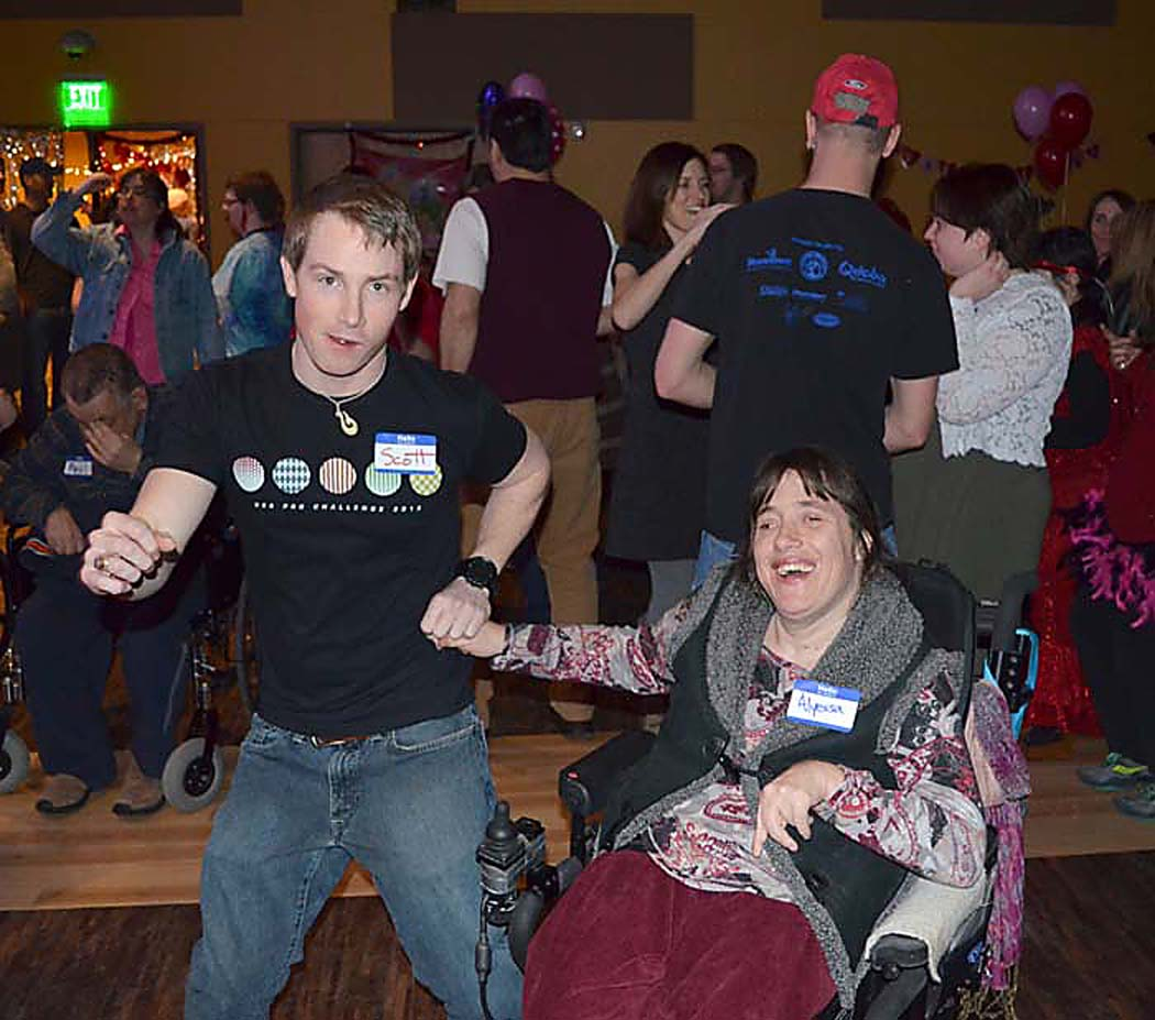 Horizons counselor Scott Larson, left, and Alyessa Yeagher, twist and shout at the Horizons Valentine's Dance.