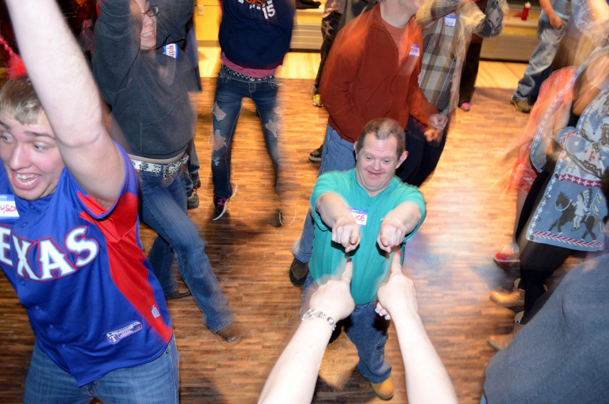 Colorado Mountain College student Brayson Pope, left, and Horizons client Bruce Rule, center, were dancing up a storm at a Valentine's party hosted by CMC on Feb. 11.