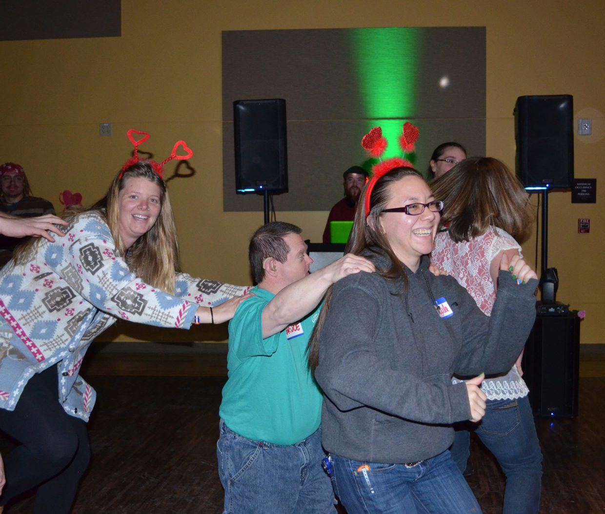 Colorado Mountain College students Tiffany Russell (left) and Abby Hayashida joined the conga line with Horizons client Bruce Rule during a wild Valentines Dan hosted by CMC's residence association.