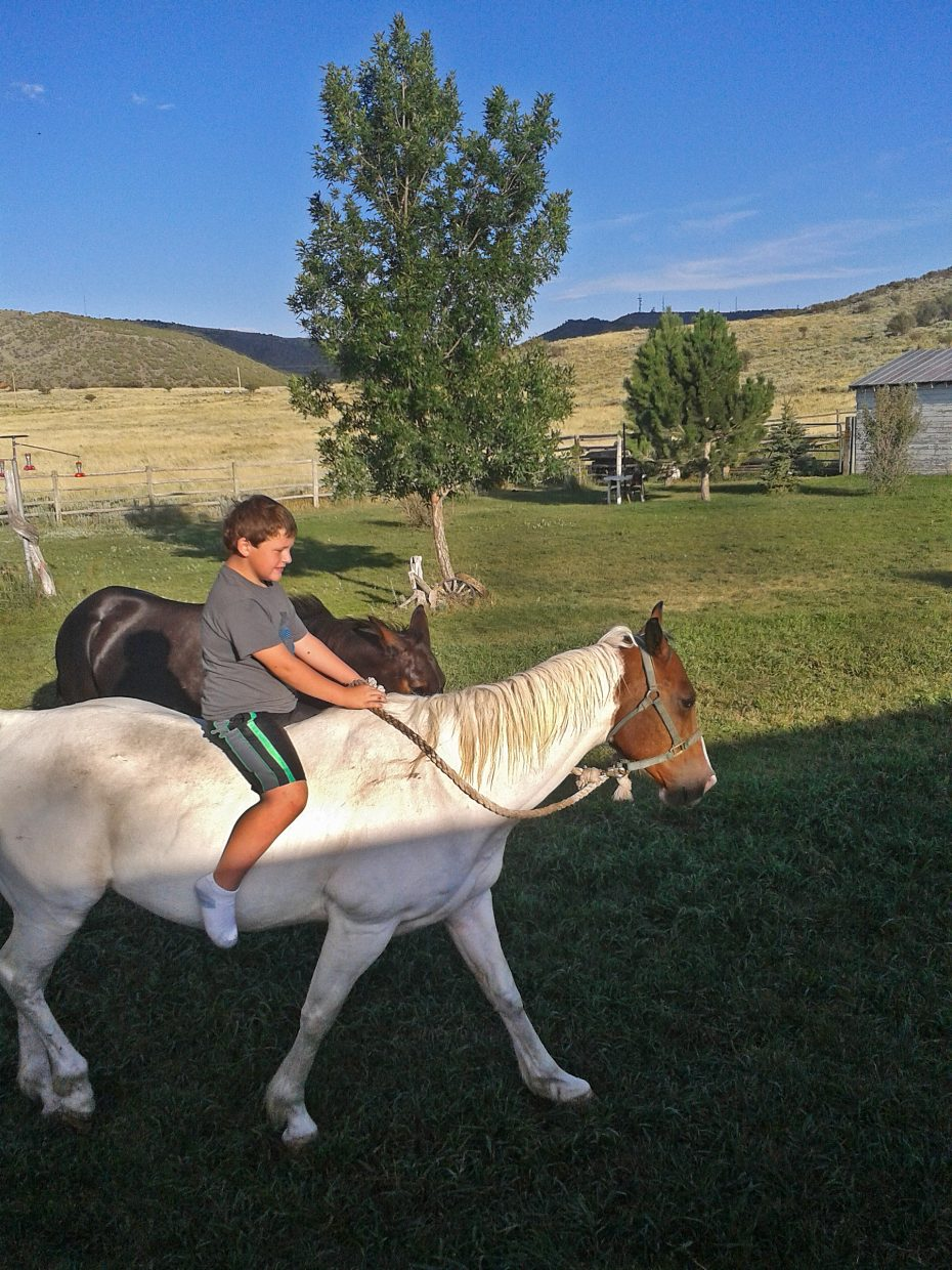 Glen and Charlotte Gariner's grandson Alex rides Cricket the horse, who died after being tied up.