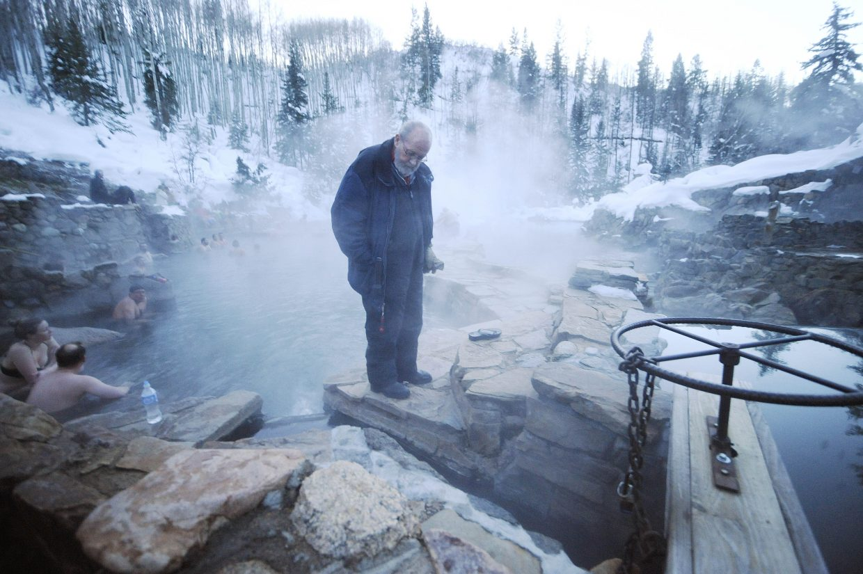 Strawberry Park Hot Springs employee Richard Leslie checks the flow of water leading into one of the pools.