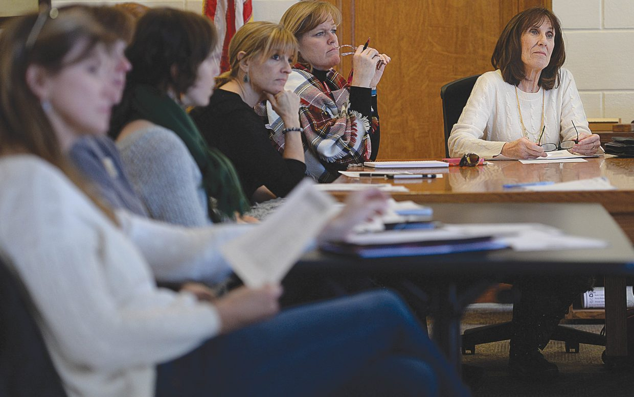 Diane Moore, right, executive director of Advocates Building Peaceful Communities, listens during the first meeting of the Housing Stability Task Force, created by Routt County United Way.