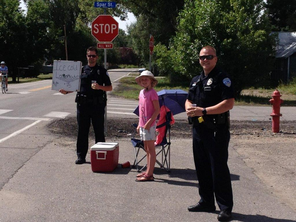 Katie Johnson, age 10 of Eagle visited the Cook family of Brooklyn this weekend. While her brother Billy was busy with hockey camp, Katie occupied her time with a lemonade stand. On Sunday, she received unexpected assistance from Steamboat's finest! Submitted by Erin Cook.
