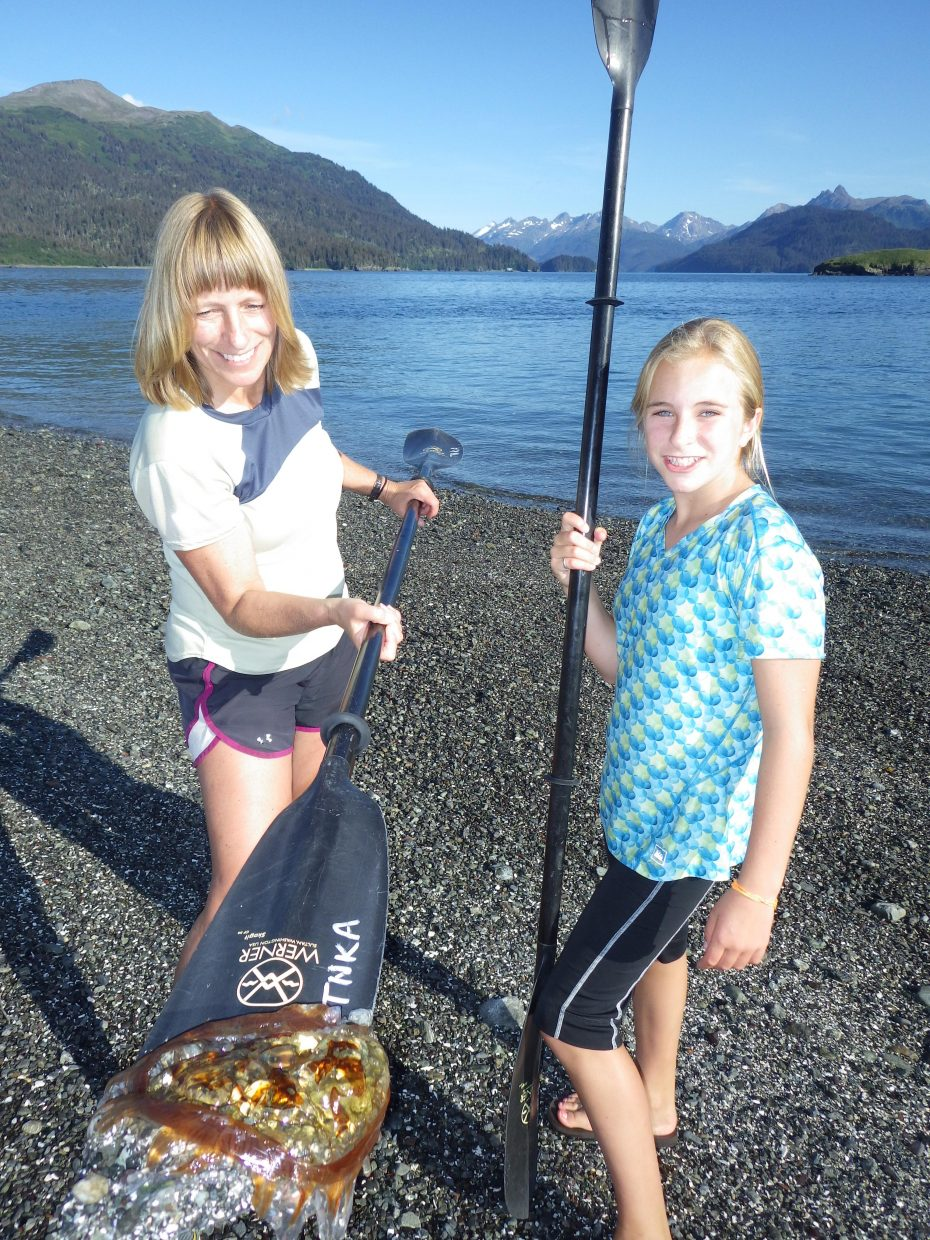 Your dinner is served. Saving stranded jelly fish with the help of a paddle blade.