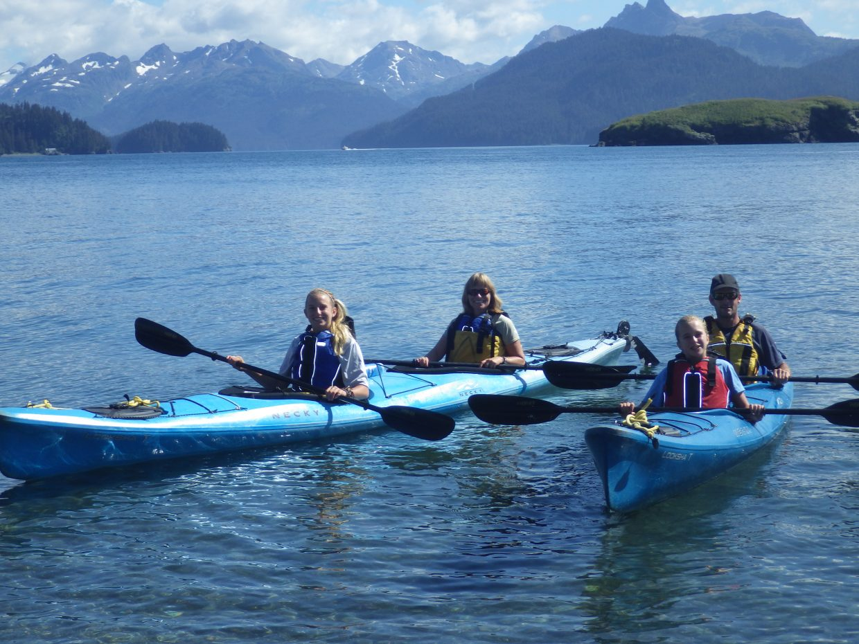 The Buchanan family (Eugene, Denise, Casey and Brooke) heading home after a paddle in Kachemak Bay.