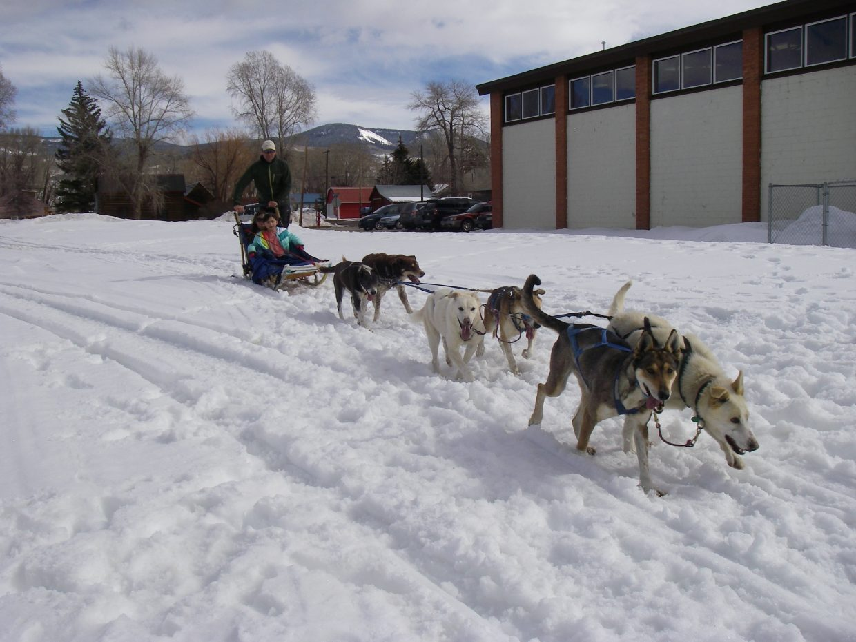 Students at South Routt Elementary were treated to a ride on a dog sled. Thank you, Tom! Submitted by Brenda Ehrlich.