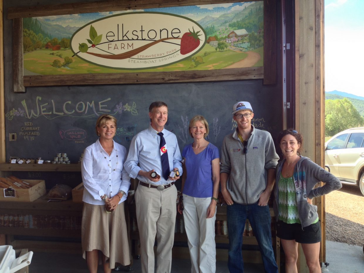 Gov. John Hickenlooper visits Elkstone Farm's stand Friday morning along with Monica Verploeg, Terry Huffington, Alex Berger and Natalie Savage.