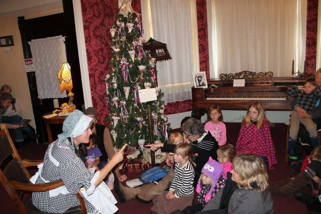 Tour guide Marianne Capra shares Pioneer Christmas Stories with children on Saturday at the Tread of Pioneers Museum. Submitted by: Candice Bannister