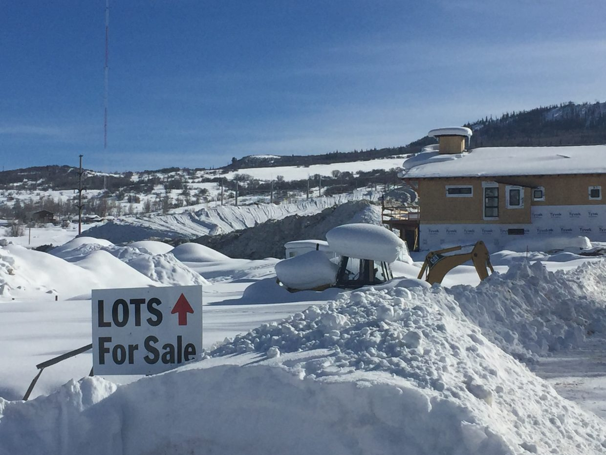The Drury family's new home, and other available lots that can accommodate residences, are situated adjacent to the giant mountain the city builds each year with removed snow.