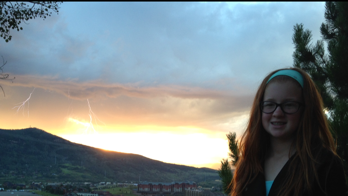 I am an avid Steamboat Today reader, and this is a photo of my granddaughter, Steamboat resident Lauren Eck. taken just as the lightening struck during one of our many recent rainfalls! I thought it was a very interesting photo! Submitted by Bob Fraser.