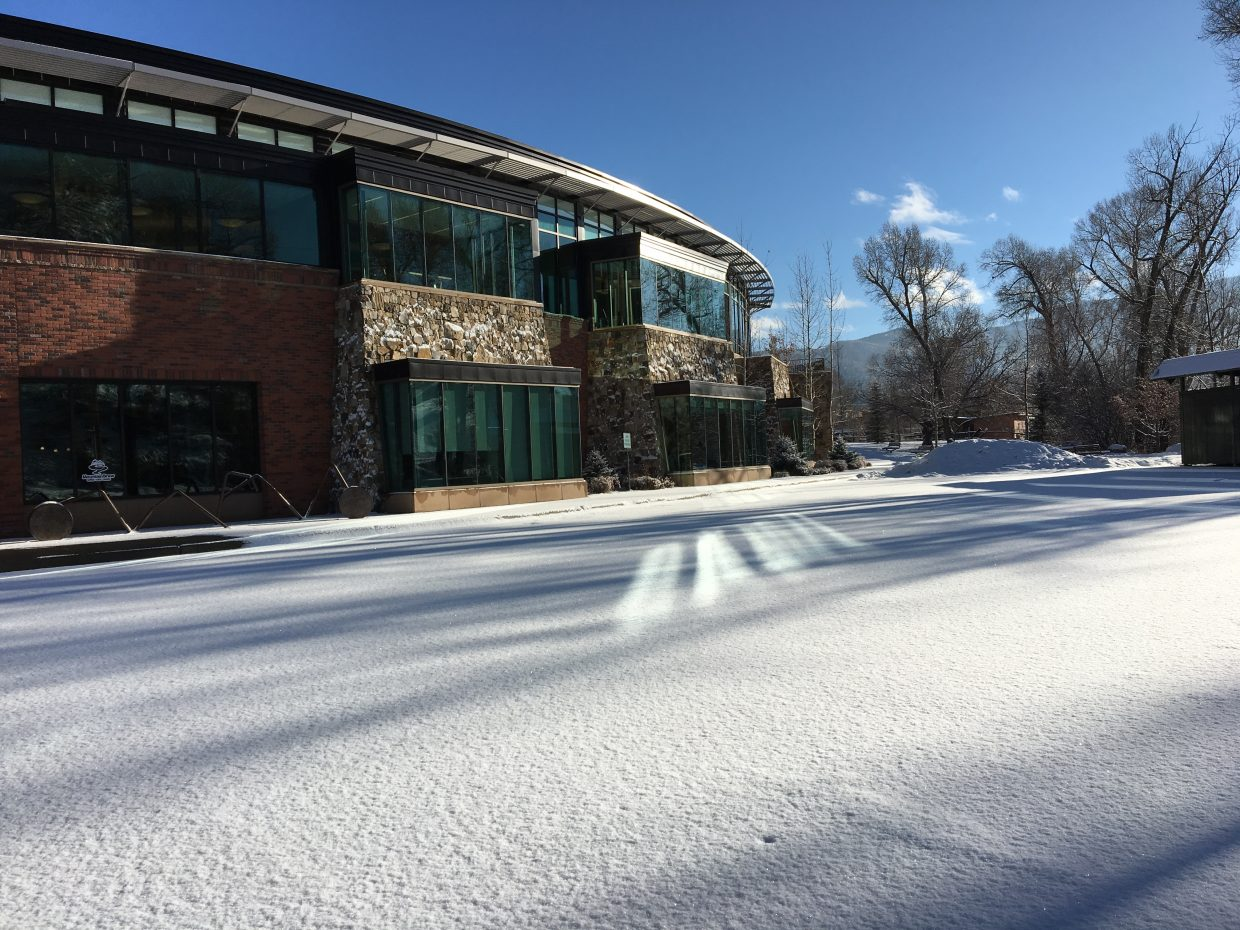 """Taken on Thanksgiving (thus the empty parking lot) during my morning walk that began on Yampa Street in an active snow storm and later after returning from the Stockbridge Transit Center just suddenly cleared when I was on the Core Trail opposite our magnificent library."" Submitted by Joe McManus."