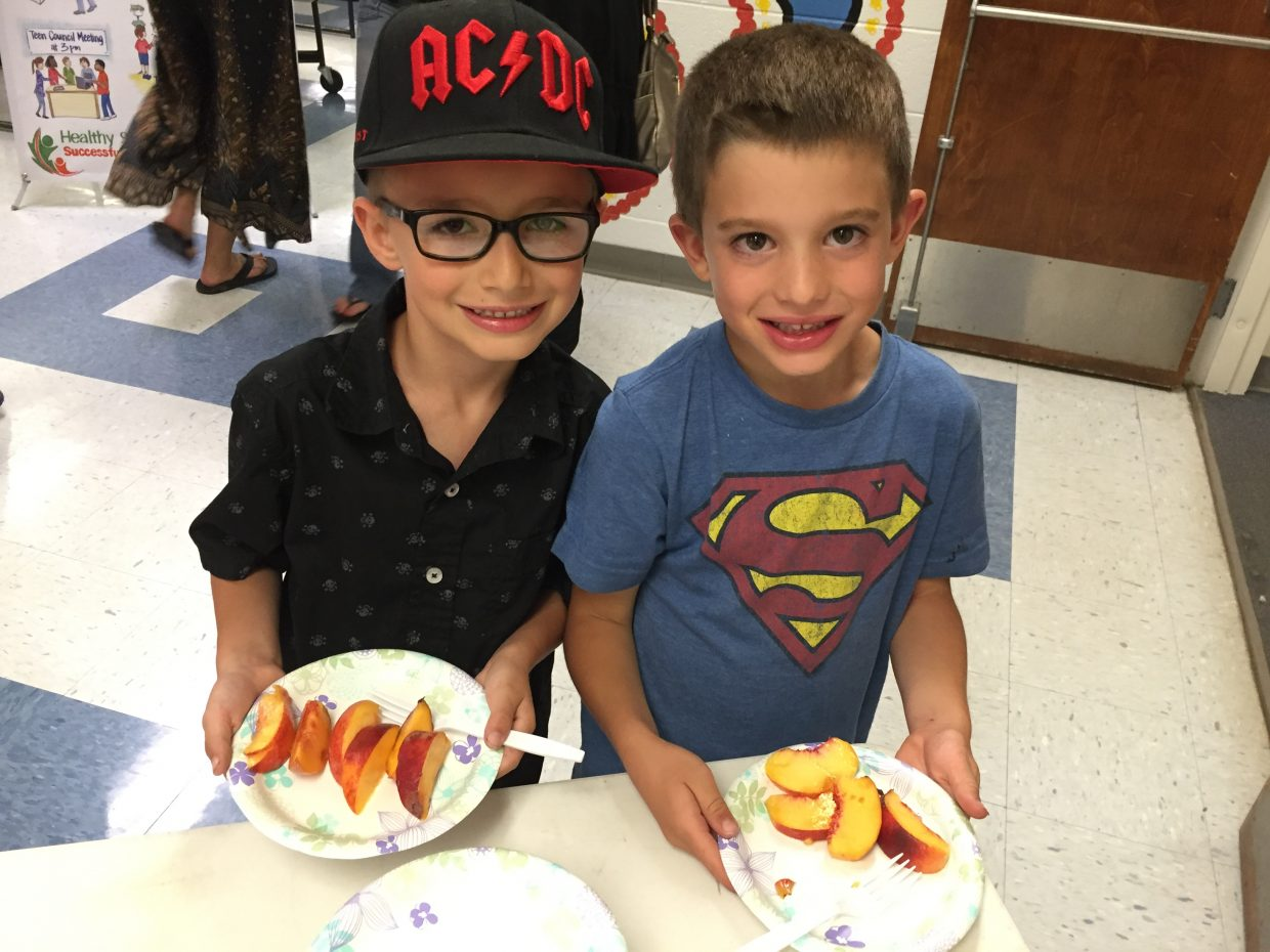 South Routt students Jace Wisecup and Jacob Kindsvater, both age 6, enjoy healthy snacks during the school week.
