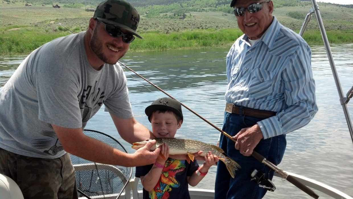 At Stagecoach Stage Park: Josh Kiser and 5-year-old son Teigen Kiser. On the right is grandpa Peter Kiser. Submitted by: Jessica Kiser