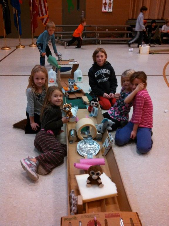 Students in the city's afterschool program had fun at a recent School Days Off event, playing with popcorn and making their own miniature golf course. Thanks to Sears, Black Tie Ski and parents for supplying the recycled materials. Submitted by: Maria Bidgood
