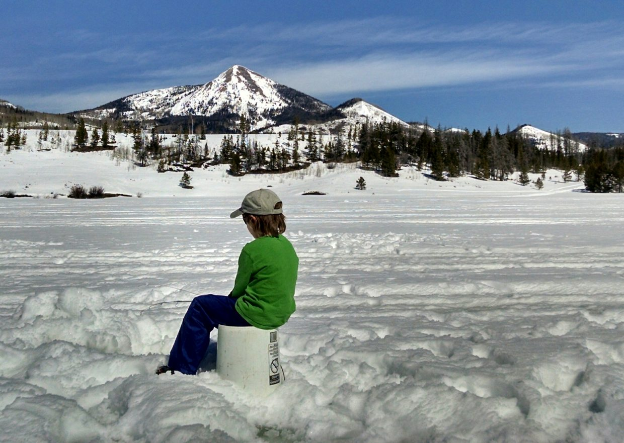 Cash DelliQuadri waits patiently to catch a trout during Sunday's ice fishing clinic at Steamboat Lake State Park. The clinic was hosted by Colorado Parks and Wildlife and Yampatika. Submitted by Elizabeth Miller.