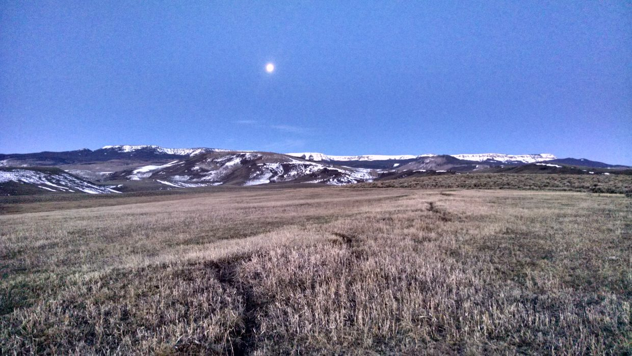 Setting moon over the flat tops. Submitted by Elizabeth Miller.