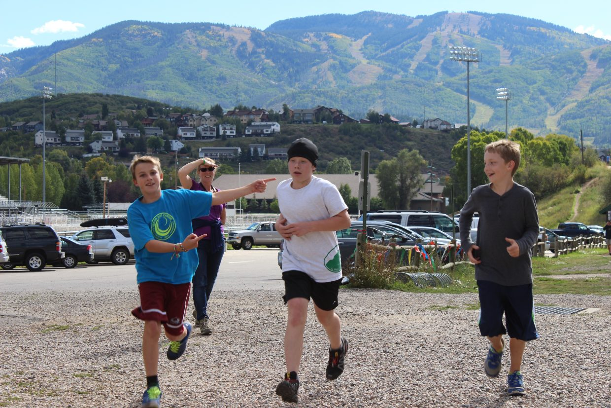 Emerald Mountain School students cheer on one of their classmates as he finishes the 12K run at the Emerald Mountain Trail Run held Saturday at Howelsen Hill. This was the last run of the season for the Steamboat Running Series. Submitted by: Debbie Gooding