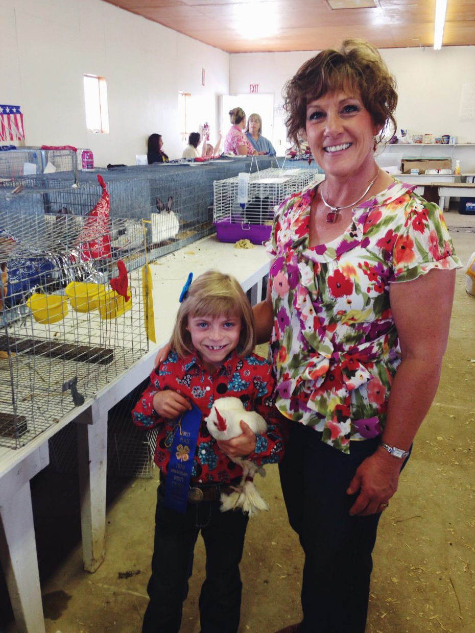 Mother and daughter Ann and Alley Kvols both showed chickens and rabbits at the Routt County Fair this week.