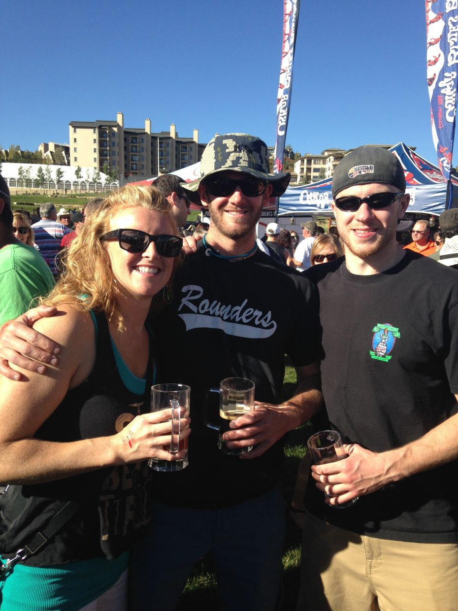 Friends Shannon Elson, Gordon Thomas, and Ryan McCarthy pose for a picture at the 2014 OktoberWest last weekend.