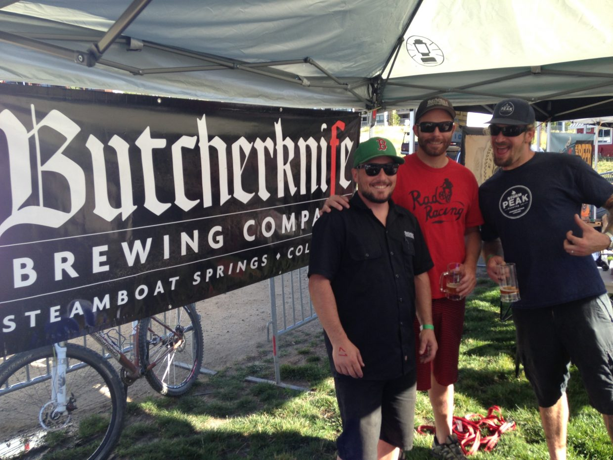 Butcherknife Brewing Co.'s Rob Day and Nathan Johansing chat with Storm Peak brewer Tyler Paterson at the 2014 OktoberWest event last weekend.