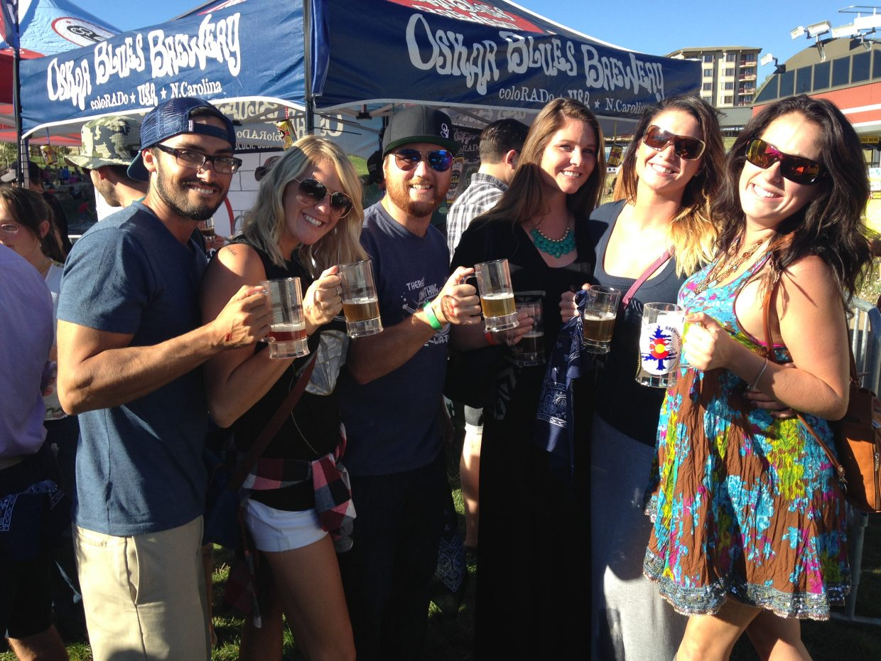 Friends Nicci Kurd, Janessa Lomas, Chris Franges, Lucky Paije, Justin Coy, and Meg Rose pose for a picture at the 2014 OktoberWest event last weekend.
