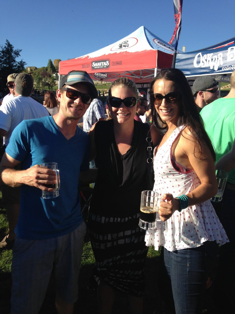 Friends Jesse Dewolfe, Katie Noble, and LaLa Cartmill pose for a photo at the 2014 OktoberWest event last weekend.