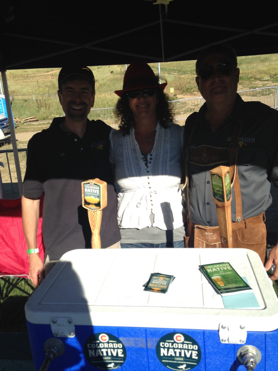 Co Native brewers Jeff Cornell, Denise Fletcher, and Steve Fletcher pose for a photo after pouring beers all day at the 2014 OktoberWest event last weekend.