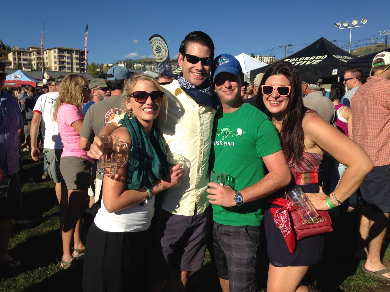 Friends Adrienne Sines, Dwight Dettloff, Matthew Purdy, and Sarah Helmstetter pose for a photo at the 2014 OktoberWest event last weekend.