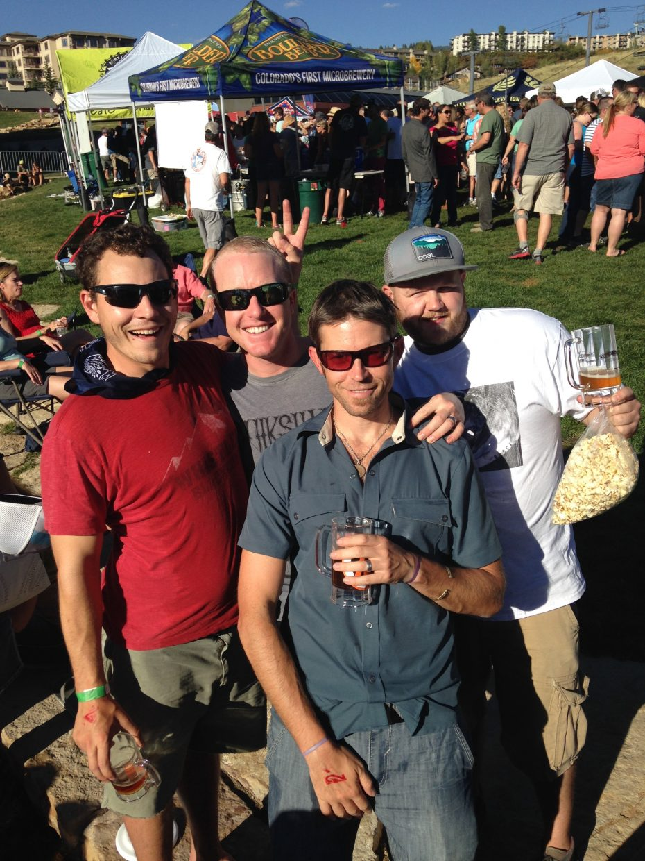 Friends Andrew Schaeffer, Billy Connor, Andy Buchholz, and Ben Engelhardt pose for a photo at the 2014 OktoberWest event last weekend.