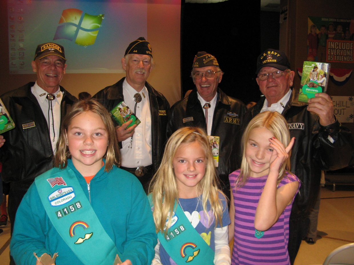 Soda Creek Elementary Girl Scouts in Troop 4158 delivering donated Girl Scout cookies to veterans. The troop collected 58 boxes in honor of our local vets. Submitted by: Courtnay Thunstrom