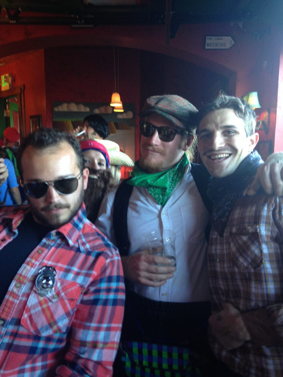 At last weekend's 2014 Mustache Ride, Tyler Goodman, Derek Stahlecker and Taze Henderson pose for a photo at McKnight's Irish Pub & Loft, the first stop on the route.