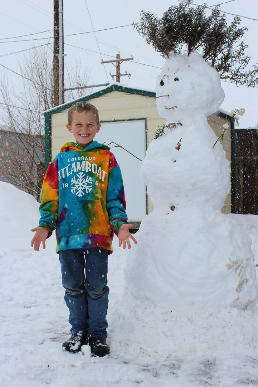 Braden Jenrich builds a snowman in the now snow that fell Sunday. Submitted by: Drew Jenrich