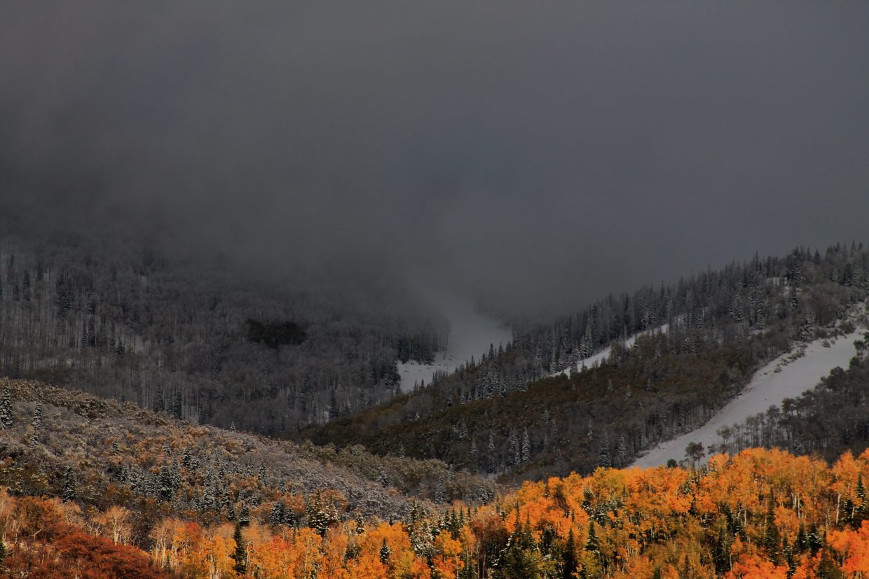 Snow swallows the aptly named storm peak as it rolls into the valley. Submitted by: Brian Savoie
