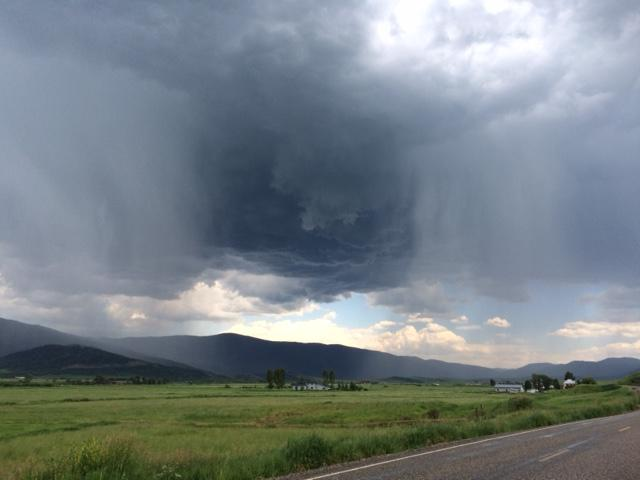 There's a storm across the valley. Submitted by Curt Merchant