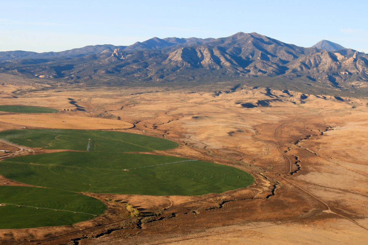 This is an aerial photo from the recent Rig to Flip film project looking out at Sleeping Ute Mountain near the Dolores River that starkly contrasts the arid desert area and the agriculture area fueled by dam that limits the amount of water of the river.