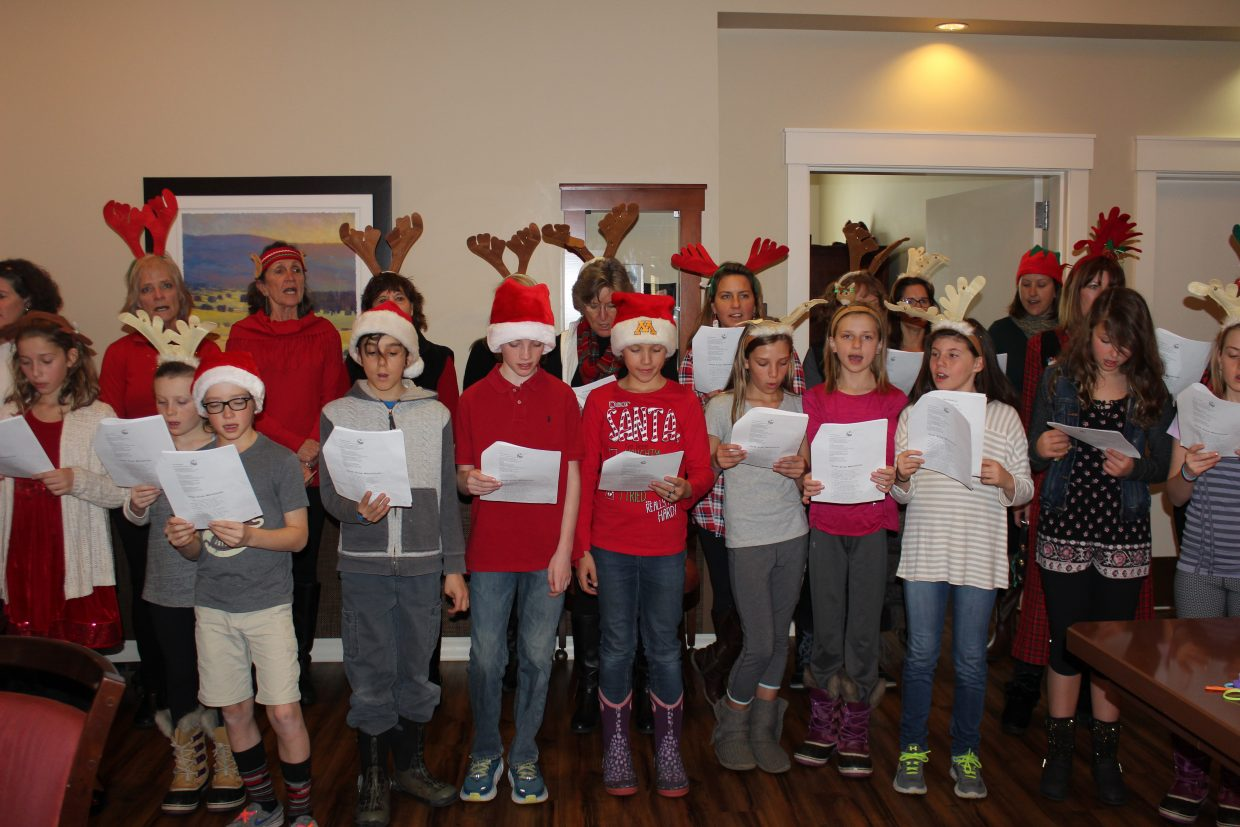 Emerald Mountain School Middle School students joined members of the Rotary Club of Steamboat Springs Tuesday to sing holiday songs and Christmas carols for the residents at Casey's Pond.