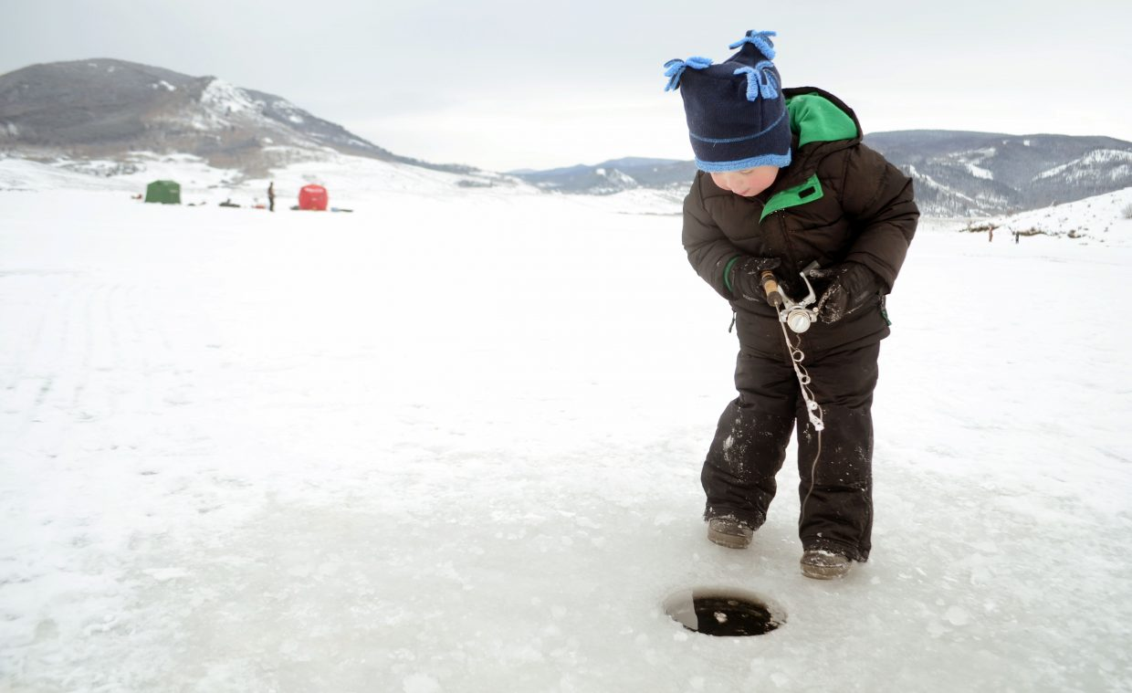 Emerson Toth, 3, of Boulder, casts his line Sunday afternoon at Stagecoach Reservoir for the fourth annual Steamboat Great Outdoors Ice Fishing Tournament. The reservoir had only been frozen for about a week, limiting area anglers could hit.