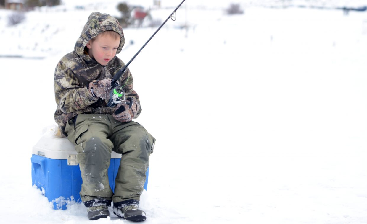 Clayton Baker, 7, of Craig, patiently waits for a bite Sunday afternoon at Stagecoach Reservoir.