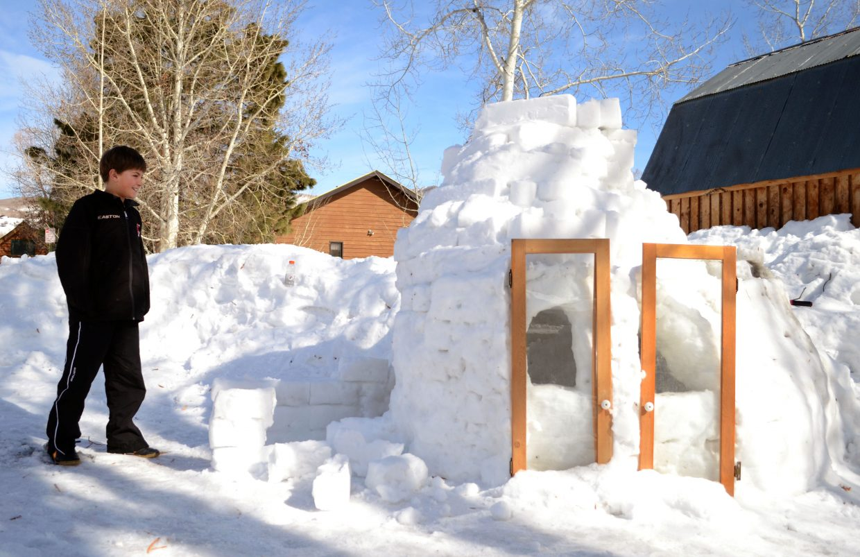 Max, pictured, and Gibby Kenney spent the past few days building their first snow fort at their home near Soda Creek Elementary, where Max goes to school. Constructed using a snow fort kit Max got for his birthday in December, the brothers spent hours during the weekend building ice bricks to make the igloo come to life. On Sunday night, they even built a fire inside, which blew smoke out of the igloo's specially designed chimney.